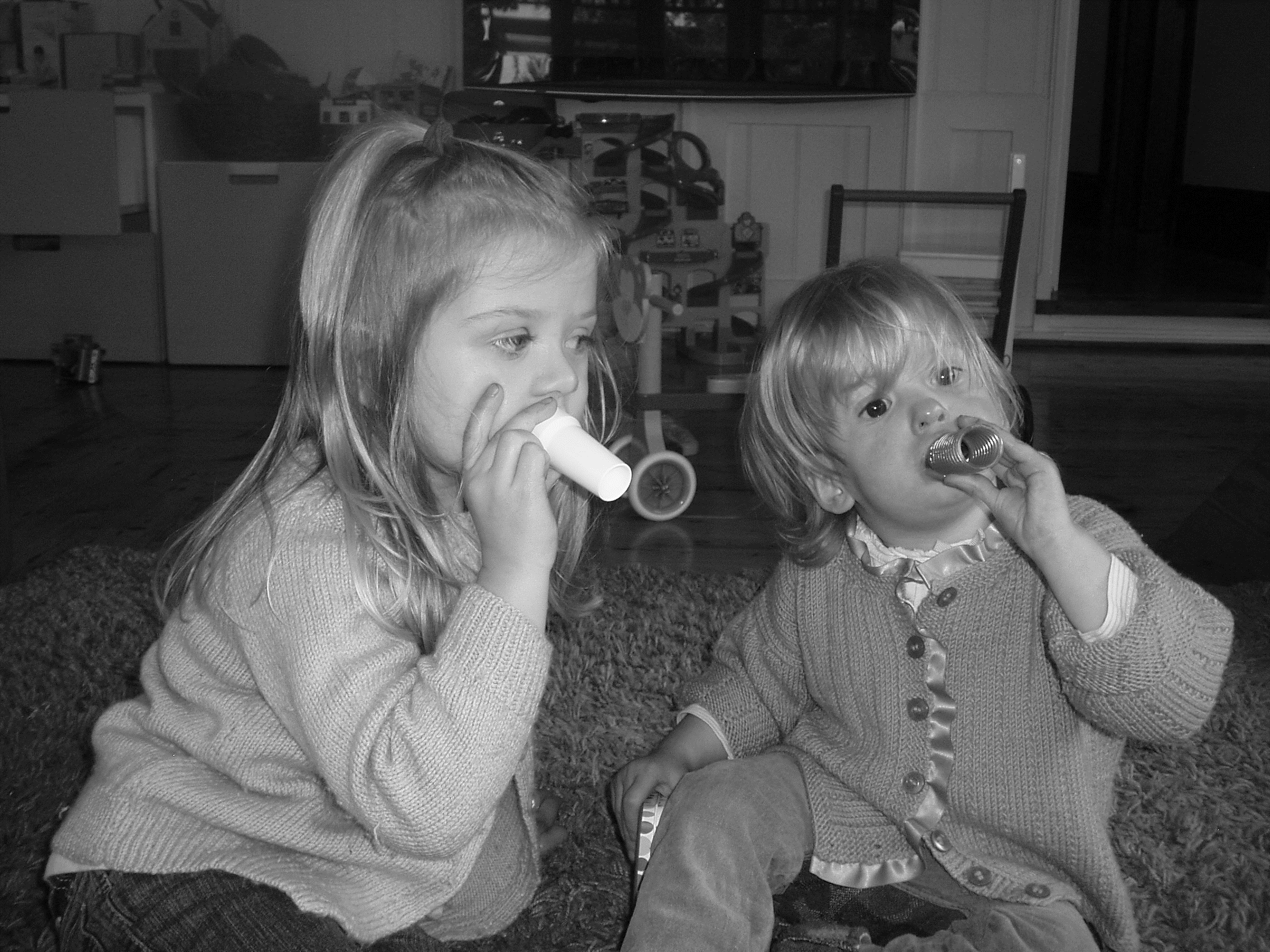 Huffing with tube two children